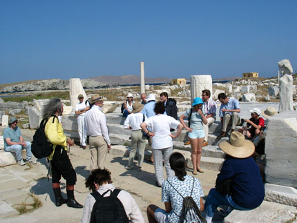 a group of participants in Delos